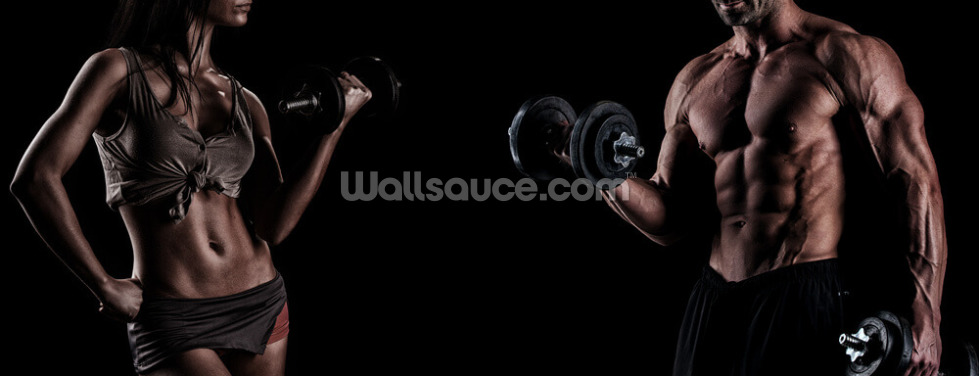 Strong young couple working out with dumbbells. Shot in studio o Wallpaper Wall Murals