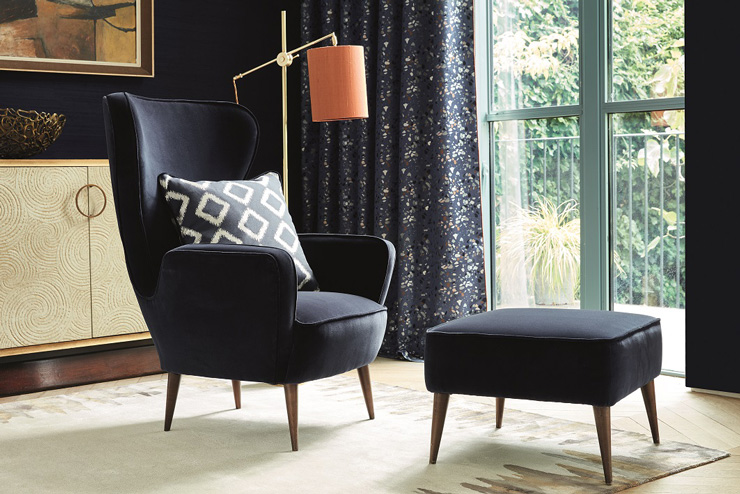 navy chair and footstool in living room