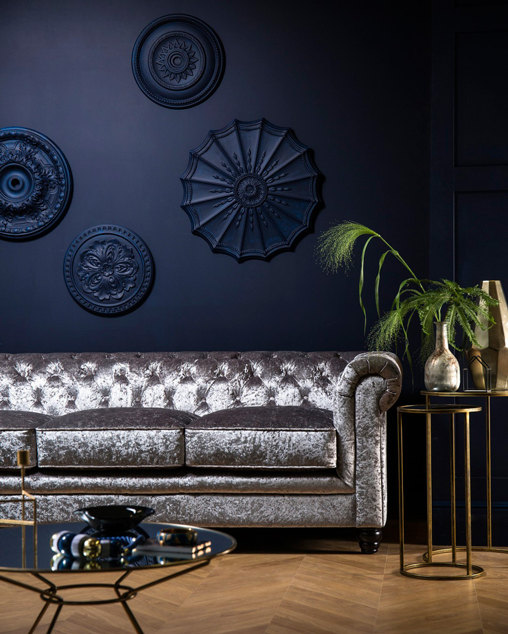 navy living room with silver sofa