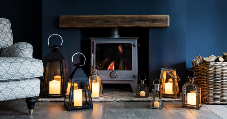cosy navy living room with lanterns