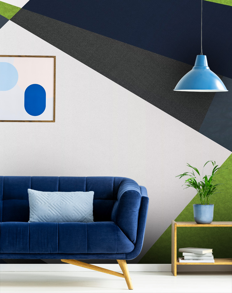 navy geometric wallpaper in living room with blue sofa