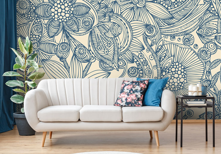 navy patterned wallpaper in living room with pink sofa
