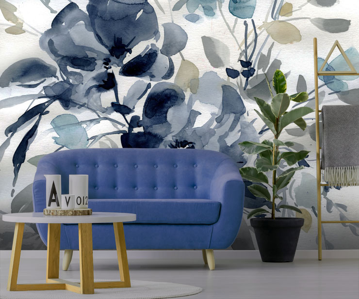 navy floral wallpaper in living room with blue sofa