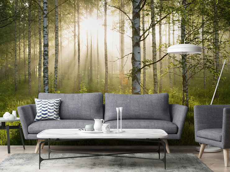 green forest mural in living room with grey sofa