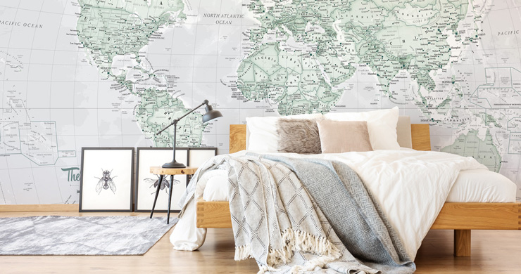 green world map mural in neutral bedroom
