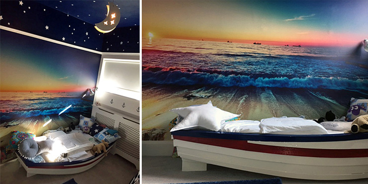 ocean wall mural in boys bedroom with boat bed