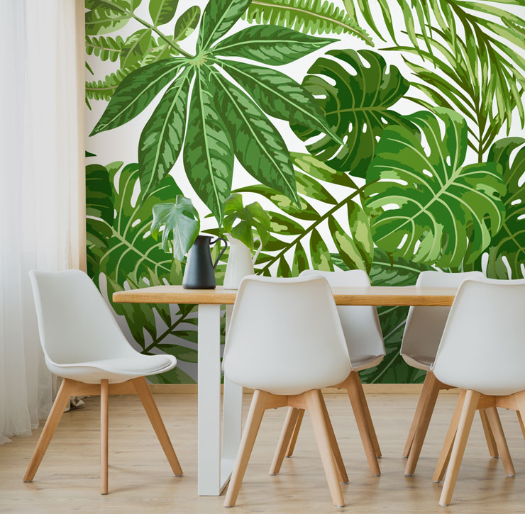 bright green jungle wallpaper behind dining table