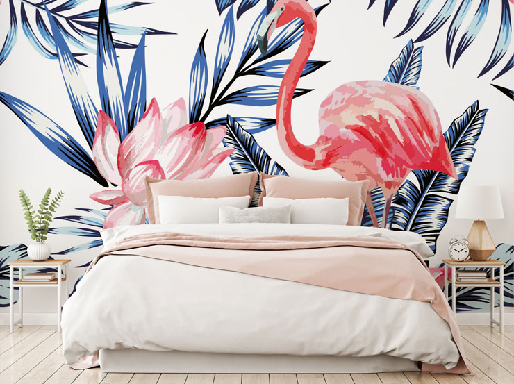 pink flamingo wallpaper behind bed