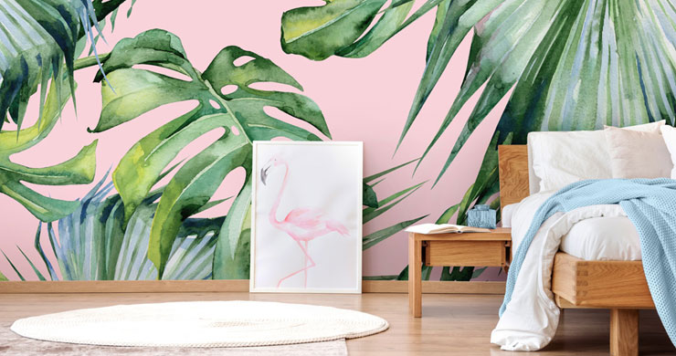 pink jungle wallpaper behind bed