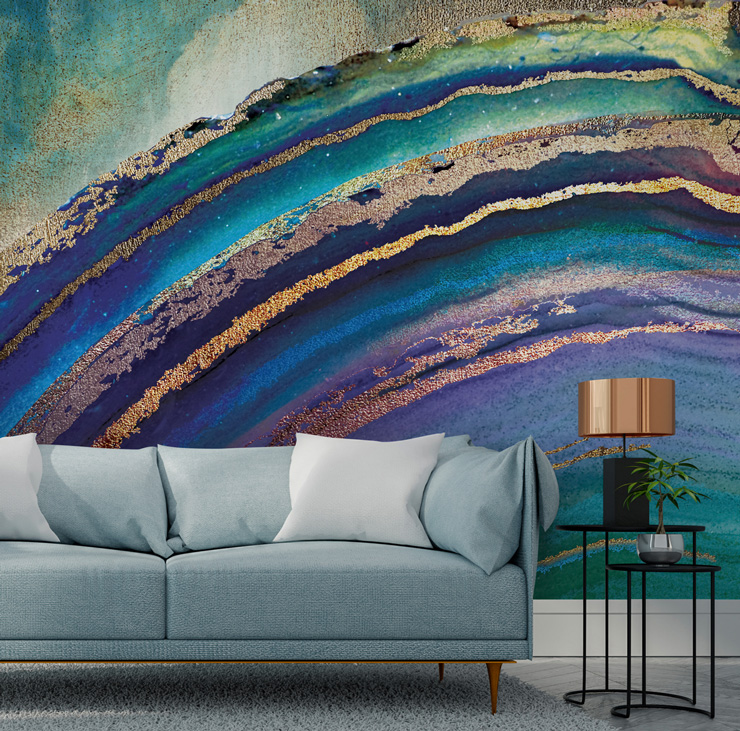 blue and bronze agate wallpaper behind grey sofa