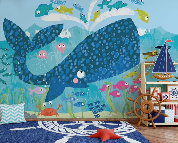 Big blue cartoon whale mural with little colourful fish