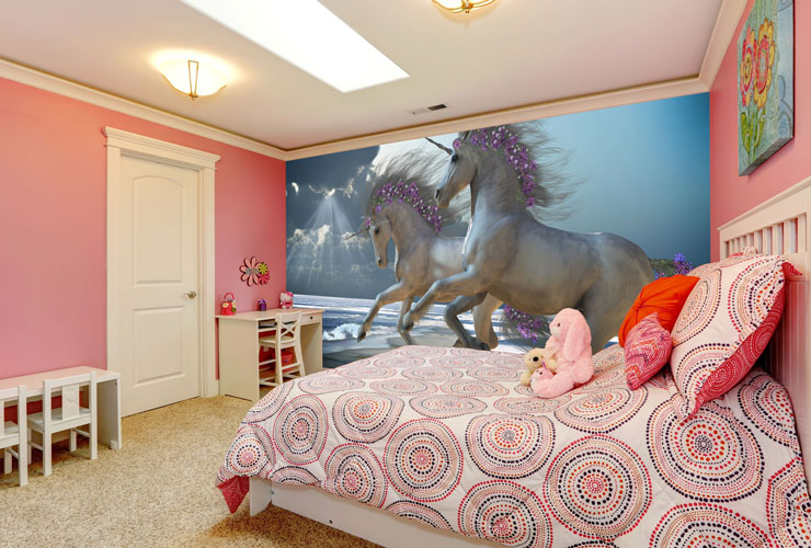 Unicorns running mural in pink bedroom