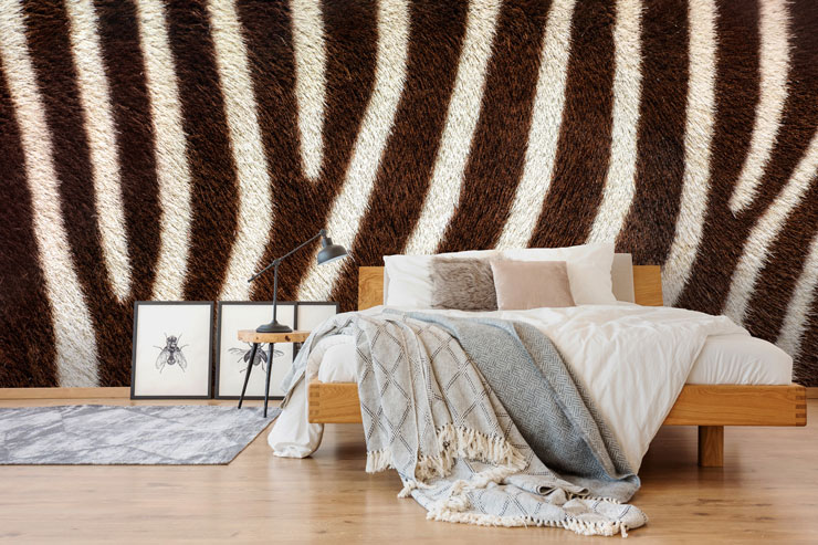 zebra print wallpaper in quirky master bedroom