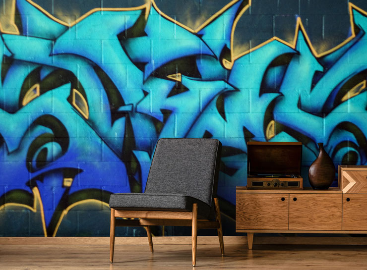 blue lettering graffiti in trendy man cave