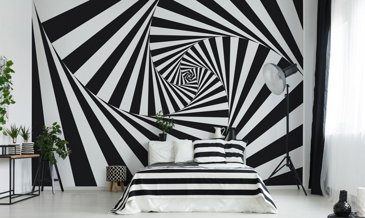 black and white optical illusion wall feature in modern bedroom