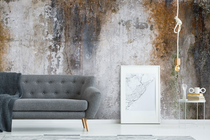 concrete and rust wallpaper in modern grey living room