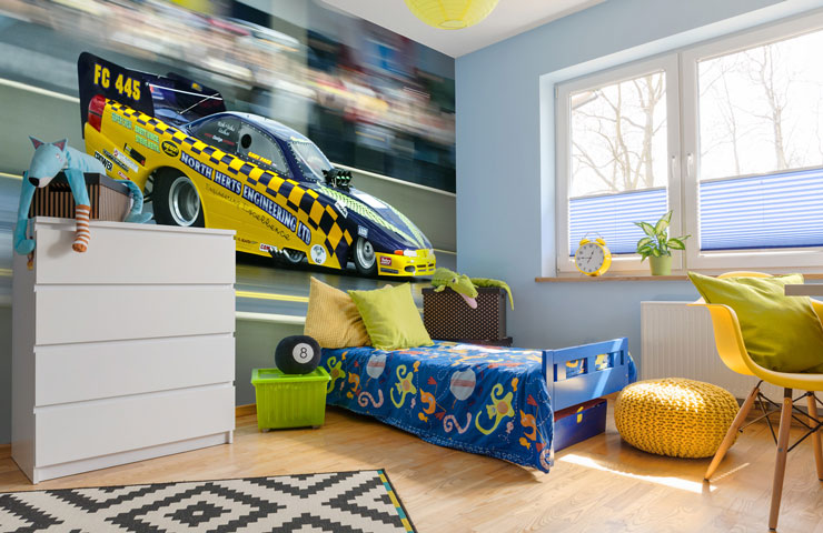 yellow and blue race car mural in young boy's bedroom