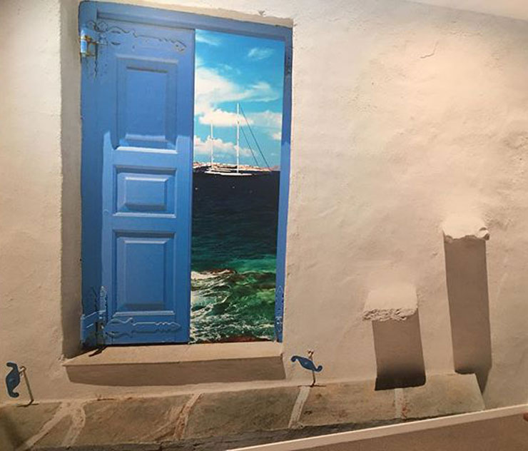greek open blue shutters to sea view wallpaper in simple bedroom