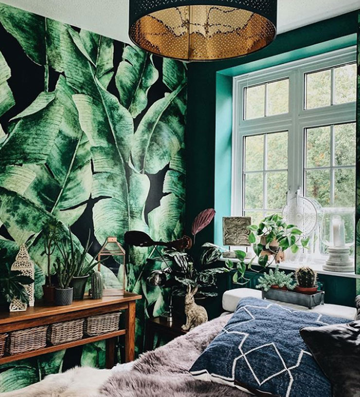 green tropical leaves wallpaper in forest green painted bedroom