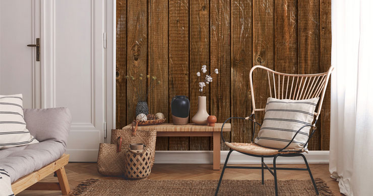 rustic lounge with wood paneled wall with hessian rug