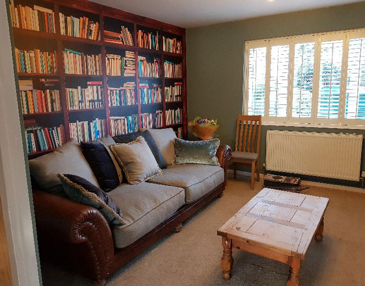 cosy living room with bookcase wallpaper
