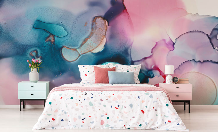 pink and blue marble effect wallpaper in trendy bedroom