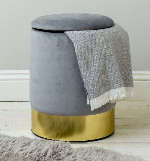 on trend grey pouffe with gold base
