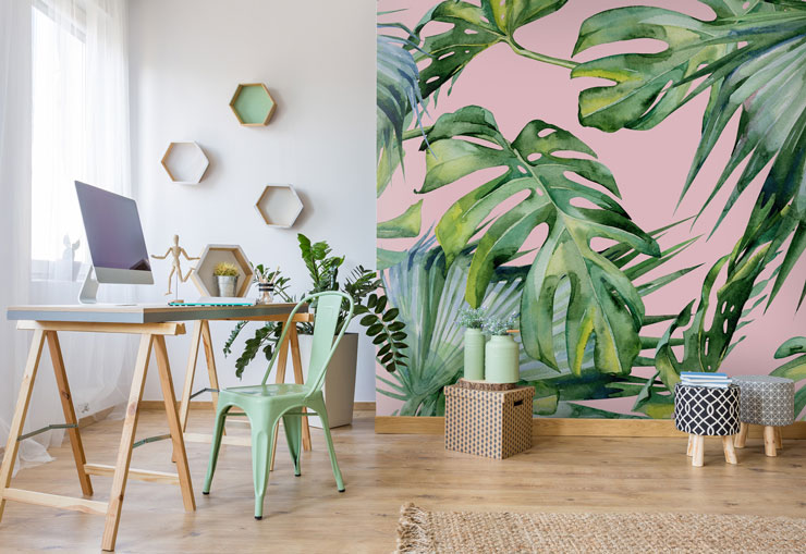 palm leaf on pink wallpaper in home office