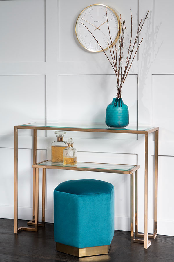 brass and glass side table with teal puoffe