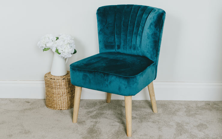 teal velvet arm chair in neutral room