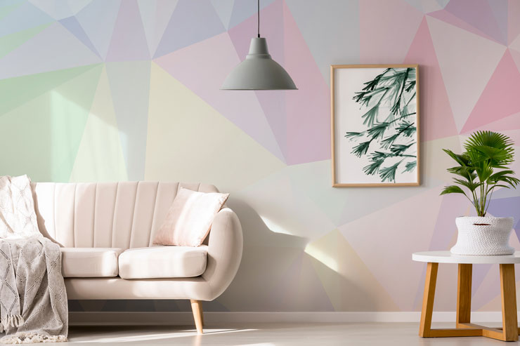 pastel pink purples and cream geometric wallpaper in modern lounge