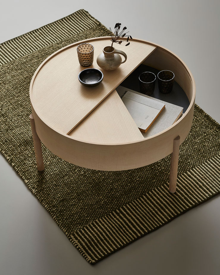natural wood circular coffee stable with geometric sliding top for storage