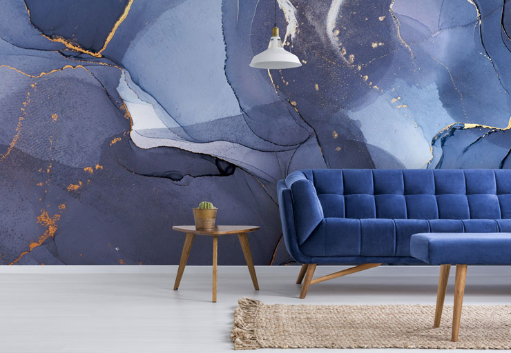 navy blue and gold watercolour wall mural in trendy living room
