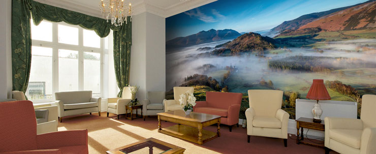 misty mountain wallpaper in comfortable care home lounge