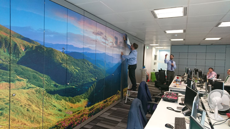 mountain view wall mural in modern office with workers