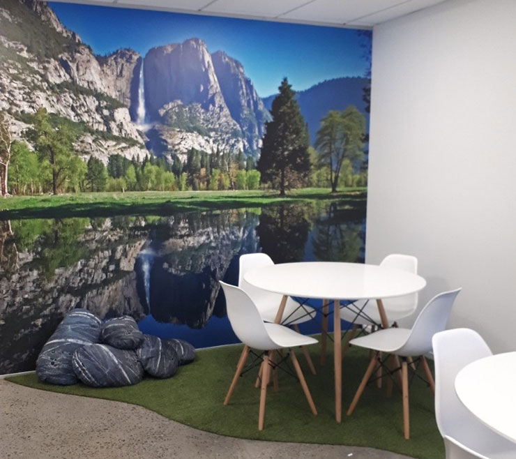 mountain and lake wallpaper in nature themed staff room