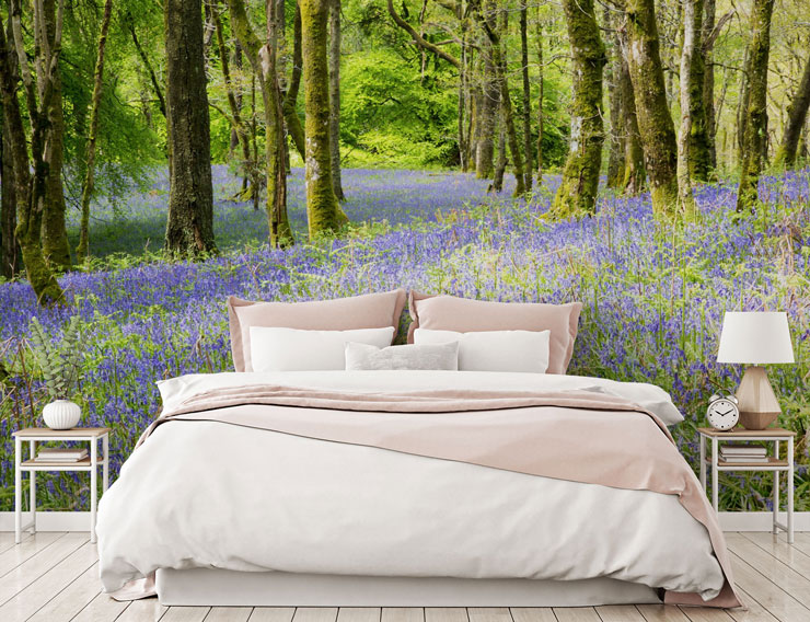 bluebell forest wall mural in minimalist pink and white bedroom