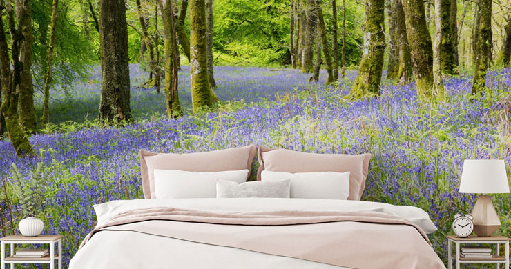 bluebell scattered forest wallpaper with white and pink bed