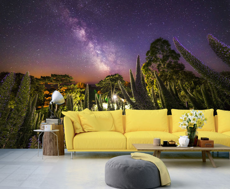 starry night sky in jungle wallpaper in yellow themed lounge