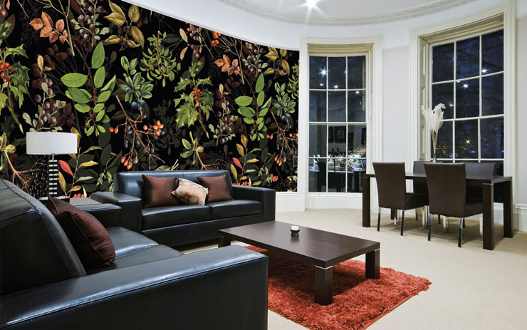 wild berries illustrations on black background wallpaper in trendy apartment