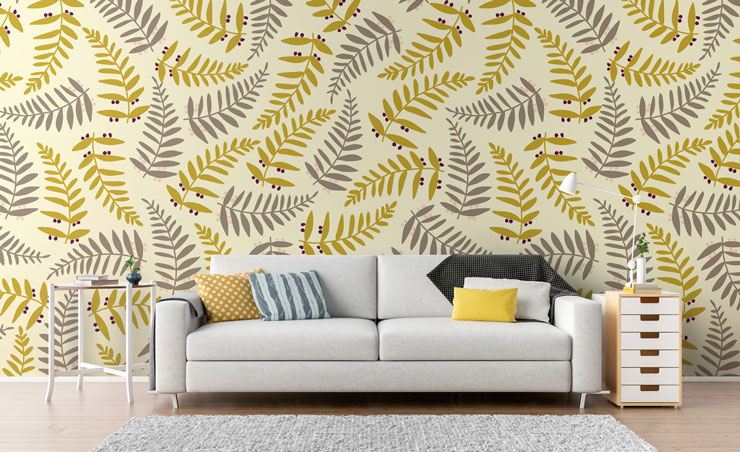 mustard and grey fern leaves wallpaper in trendy lounge