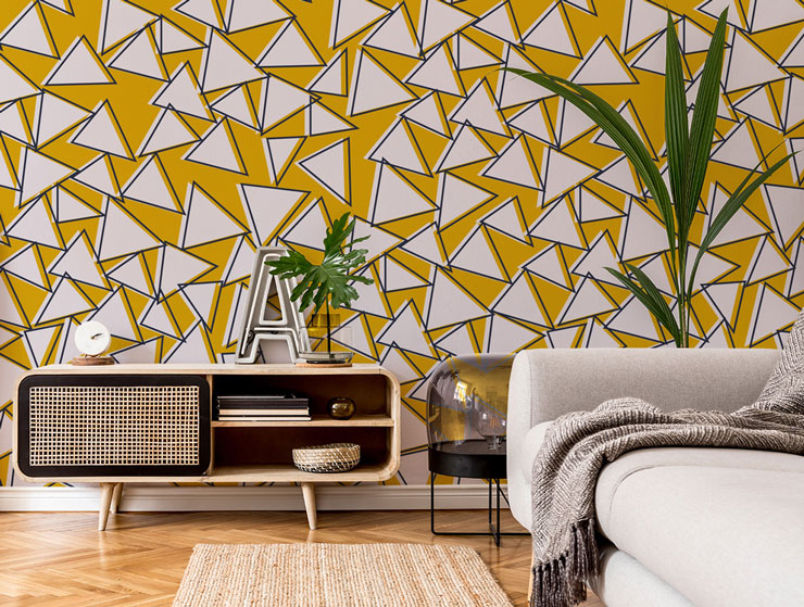 white triangles on mustard background mural in stylish lounge