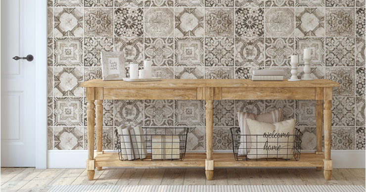 grey and white vintage tile effect wallpaper in white hallway with wooden table