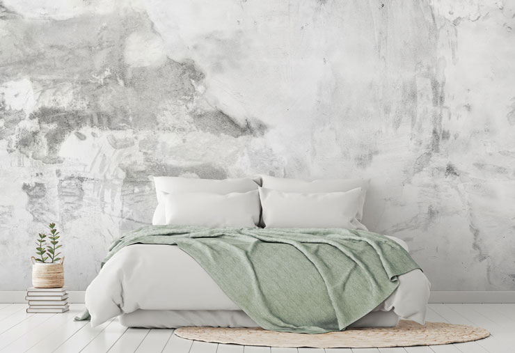pale white and grey plaster textured wall mural in pale sage and white bedroom