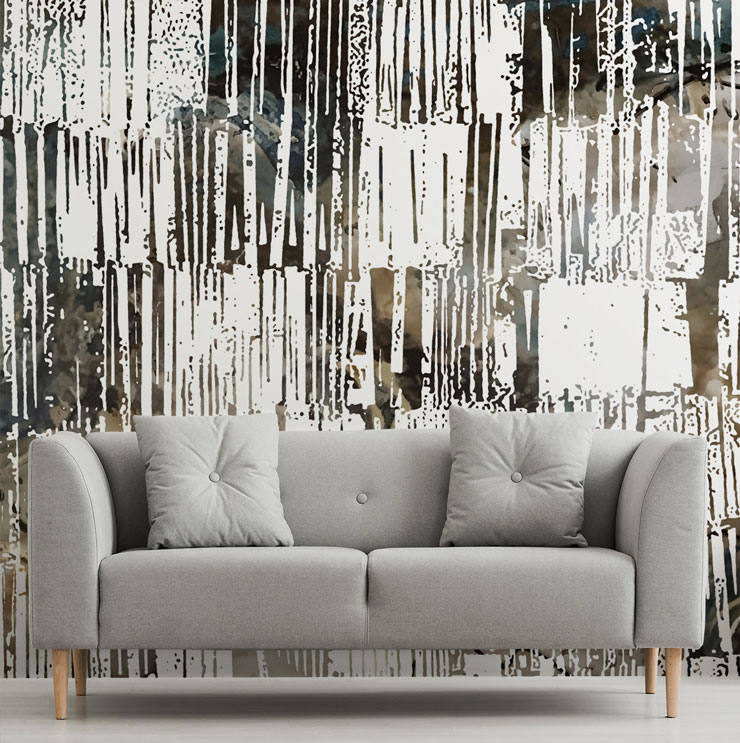 tribal patterned brown and white wall mural with grey sofa