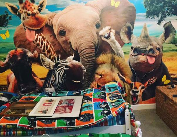 friendly african animals taking a selfie wallpaper in colourful child's bedroom