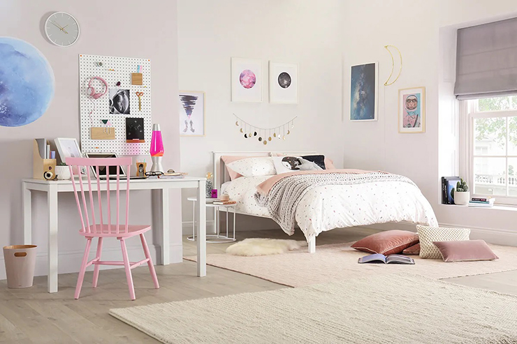 white desk, chair and bed in stylish teenage girl's bedroom