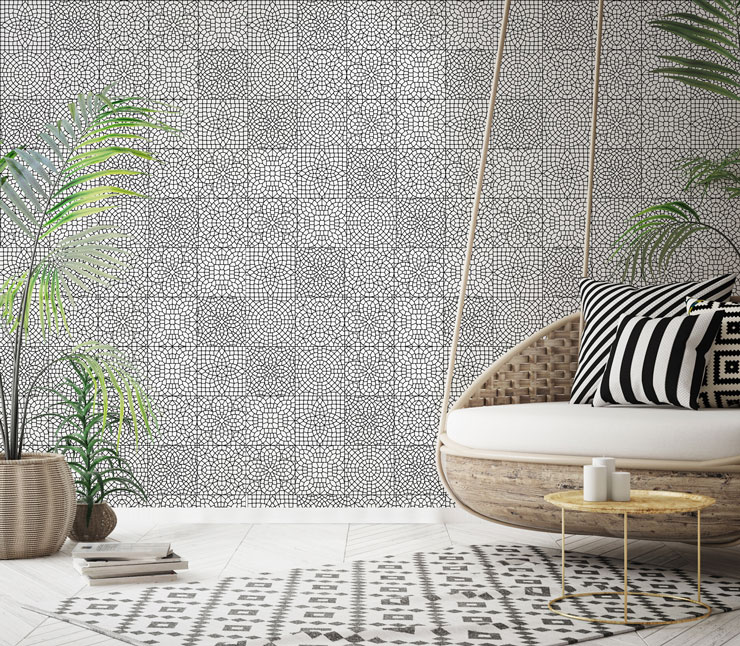 black and white patterned moroccan tile wallpaper in trendy boho lounge