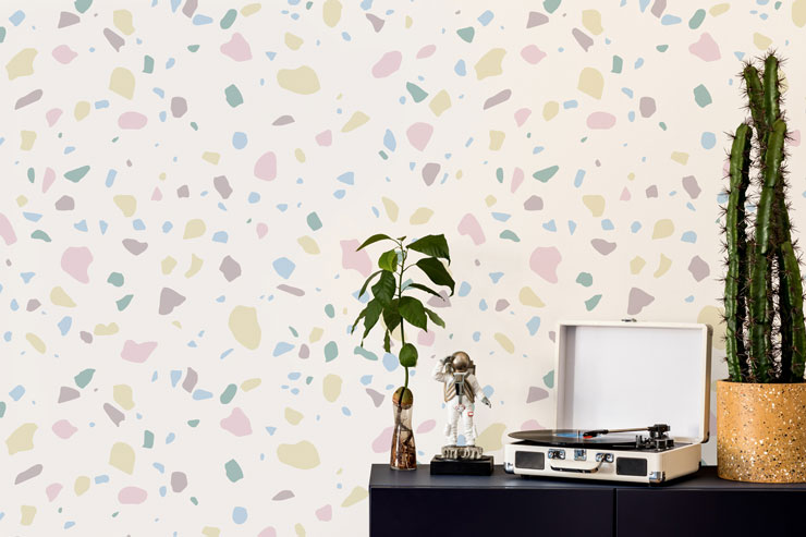 white background and pastel pink and lilac terrazzo wallpaper old record player and astronaut ornament