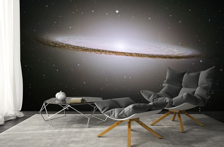 sombrero galaxy wallpaper in cinema room with cool grey recliner chair